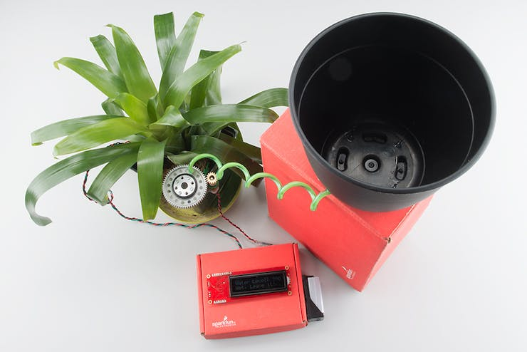 Soil moisture sensor with self-watering system