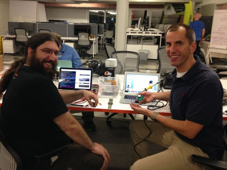 In this photo: Jeff (L) has finished enough of the app to fire the laser. Jason (R) is holding something.