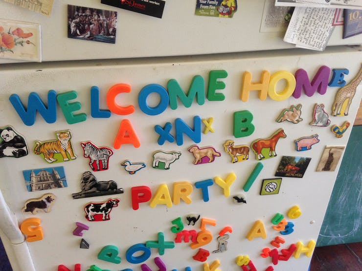announcing a welcome home party with letter magnets