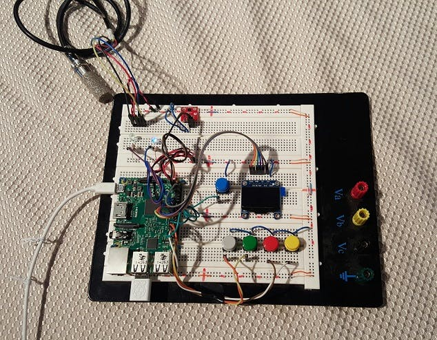 The controller exposed on a breadboard. Soil sensor is hanging off the top-left of the board.