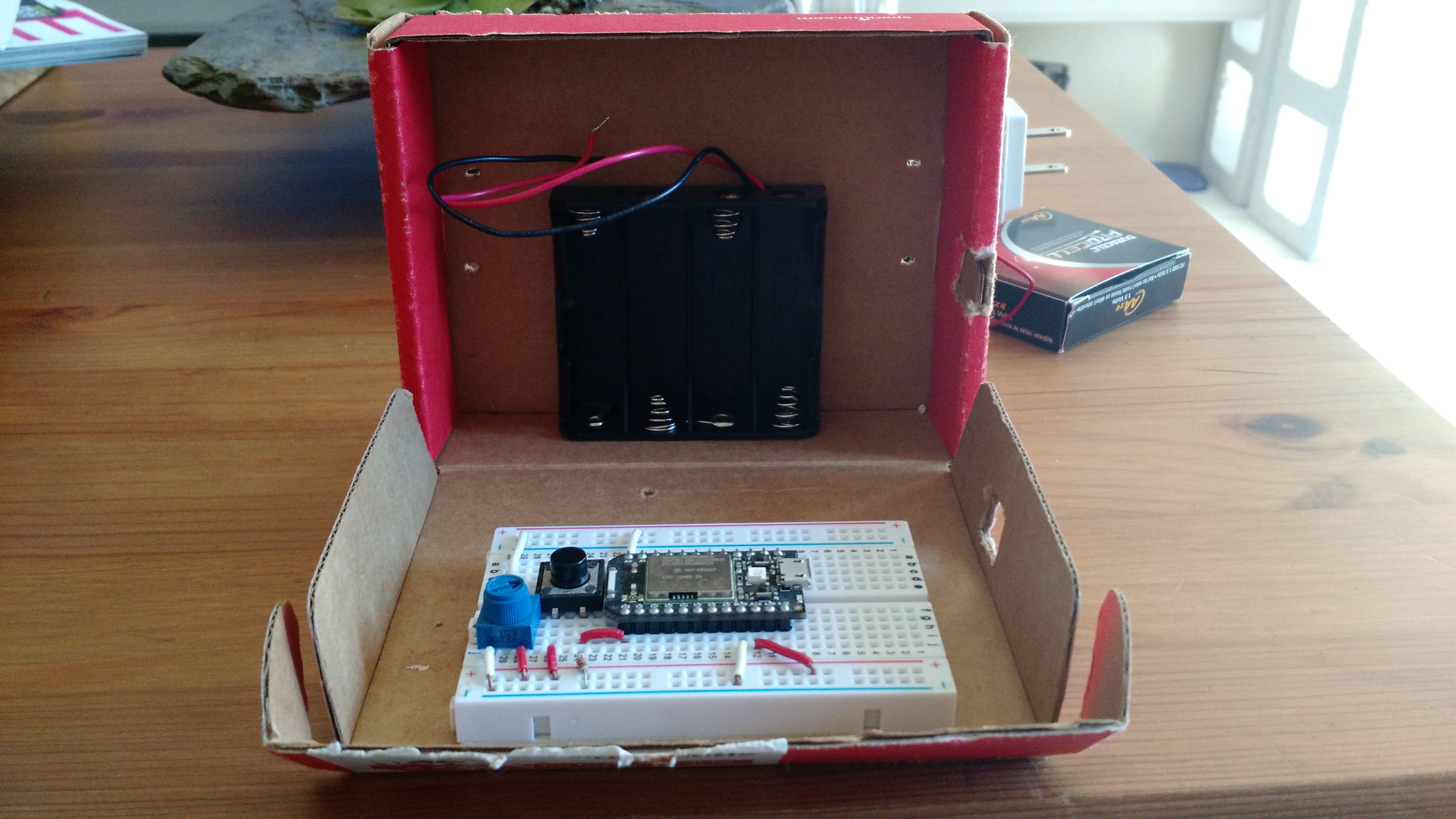 The breadboard and batter holder installed inside of the opened project box.