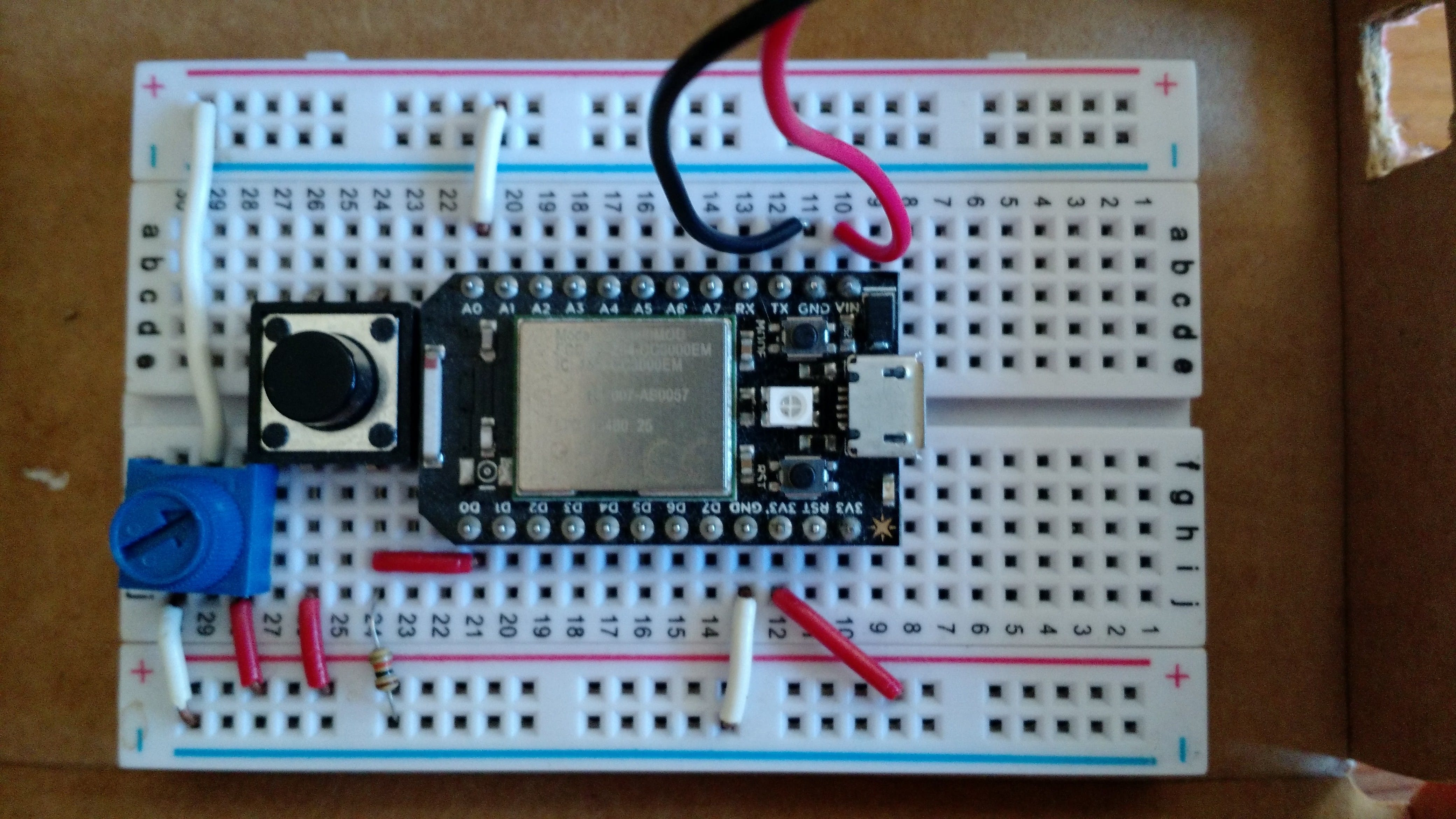 The photo shows a push button and a potentiometer which is not required for this build.