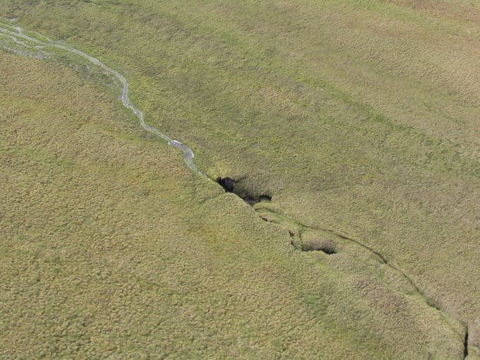 This is the thermokarst failure on a stream leading into the Toolik River on the day Breck Bowden and Michael Gooseff discovered it in 2003. (Courtesy of Michael Gooseff)