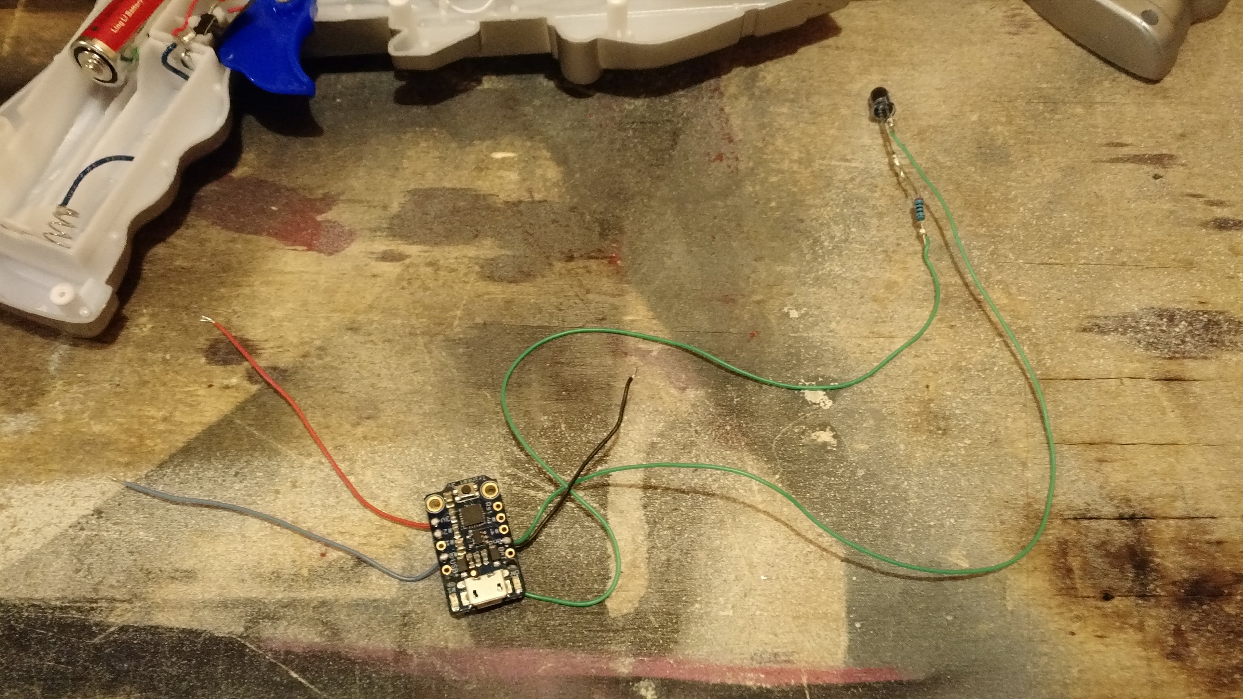 Trinket wired up with the IR LED, power, ground, and trigger sense lines