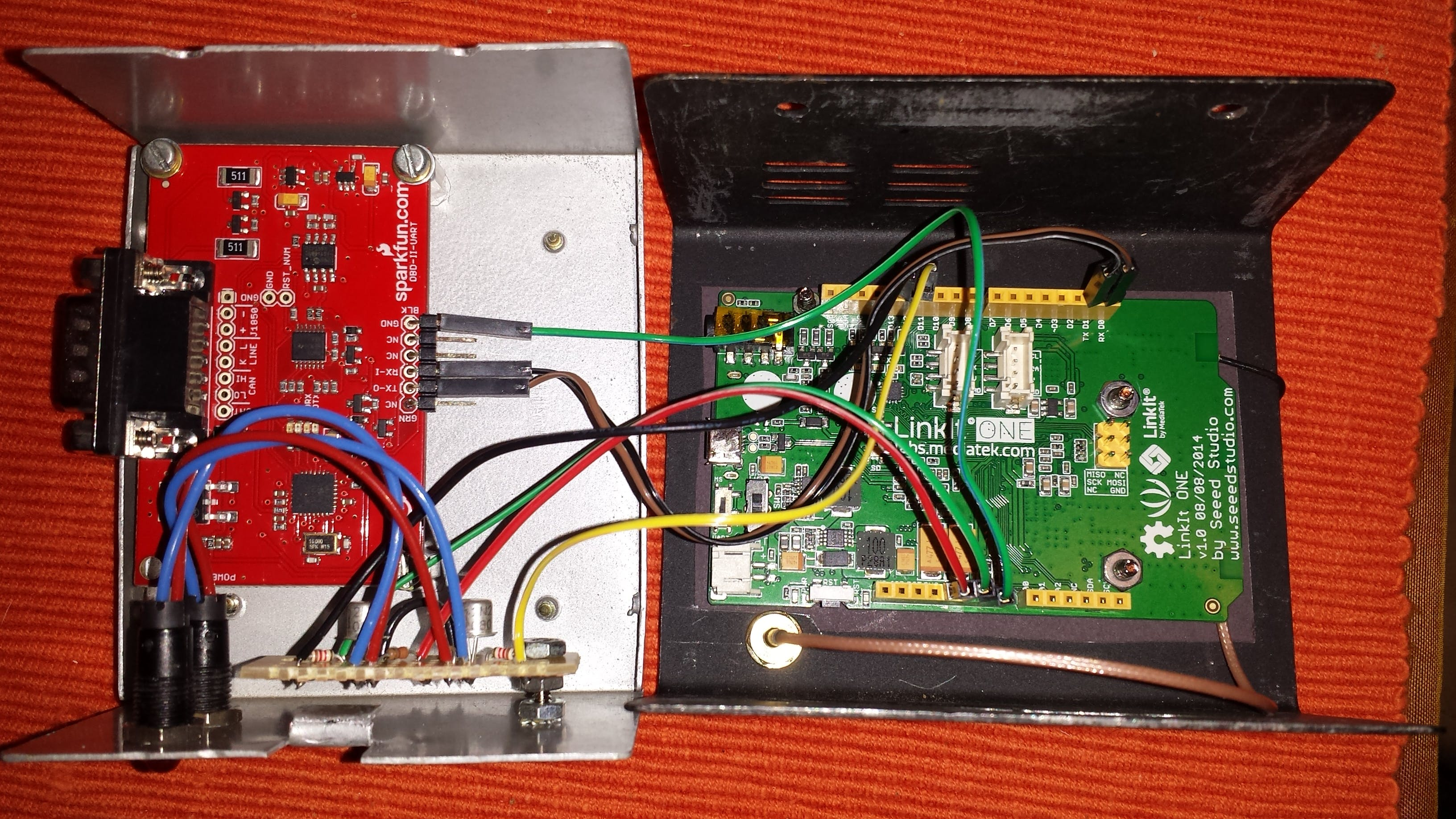 Inside box with OBD2 uart, LED drivers, Linkit One and gsm antenna cable