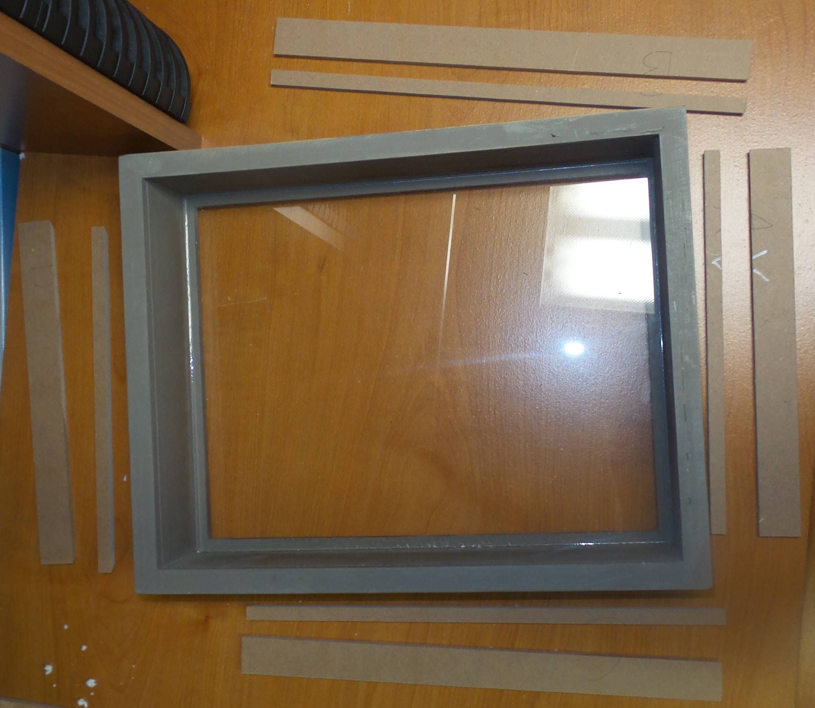 4 sides of the frame with a slot cut in each