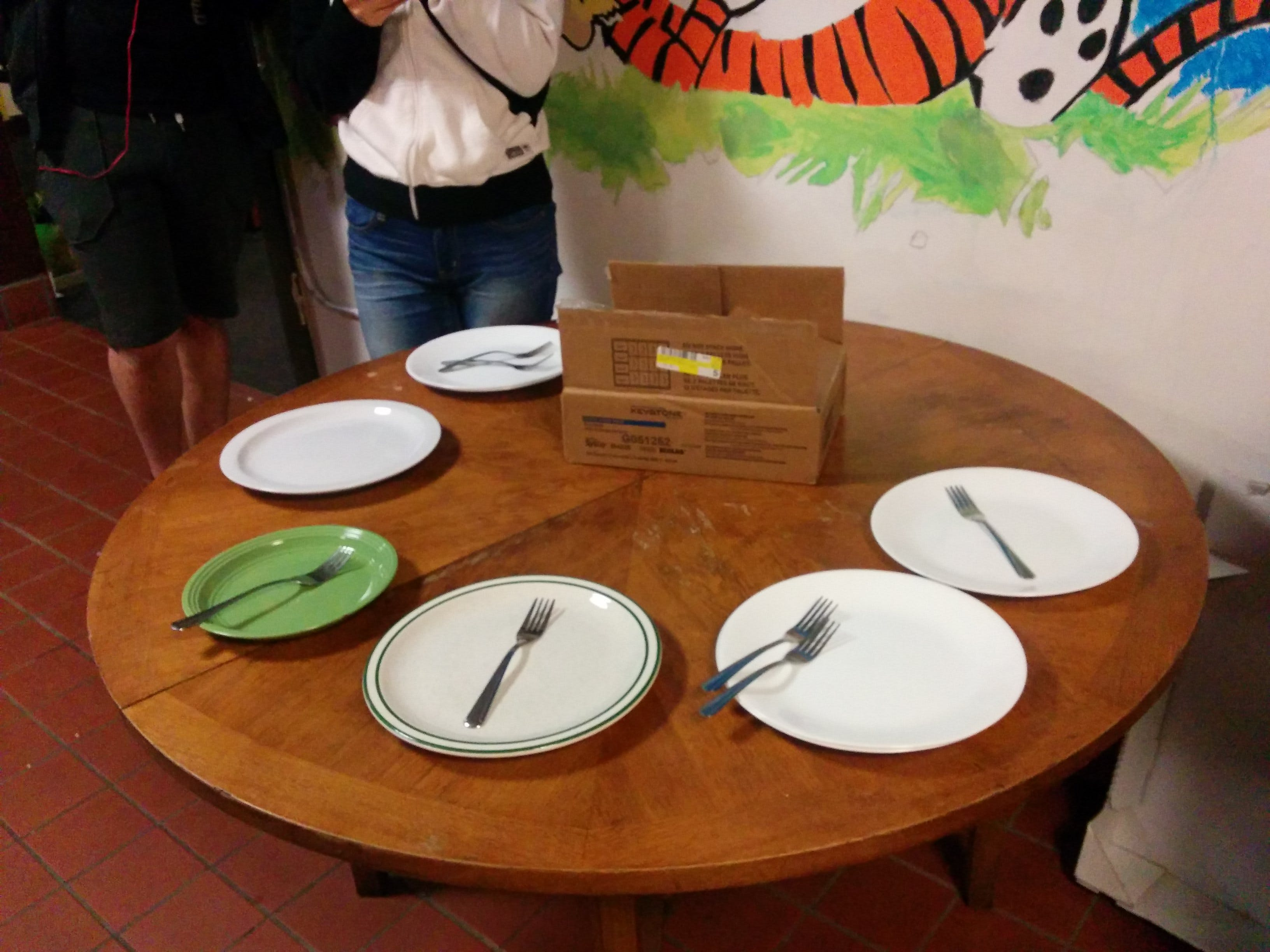 Some residents place plates to hold their spots in line